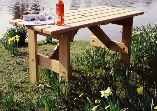Adapted garden table for wheelchairs by lake