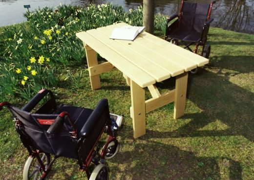 Adapted garden table for wheelchairs