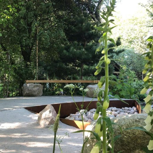 Shrubbery masking the Family Monsters bench at the RHS Chelsea Flower Show