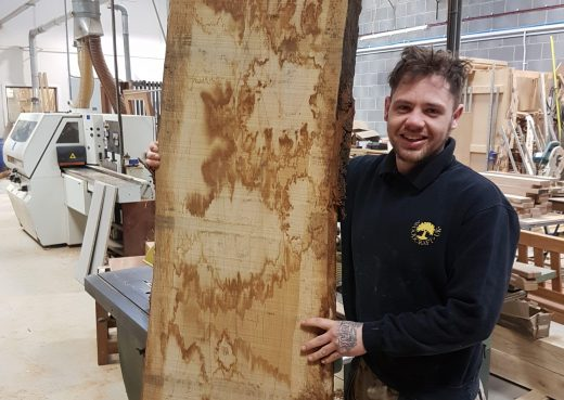 Luke with the raw hardwood section