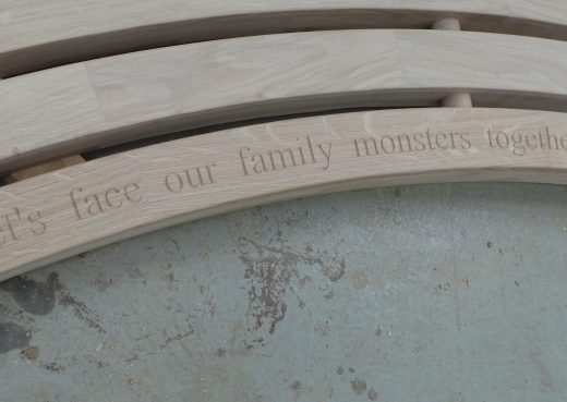 Bench engraved with the words: let's face our family monsters together