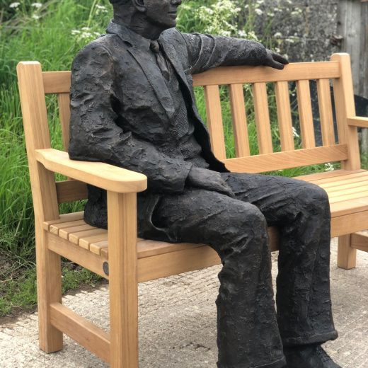 Side view of Arthur the bronze sculpture on our garden bench