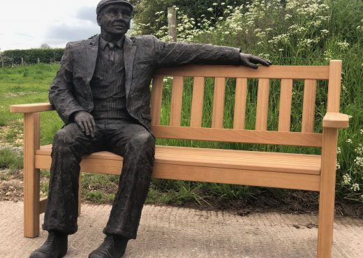 Arthur the bronze sculpture on our garden bench