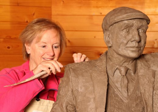 Jill Atley working on a Yorkshireman on a bench sculpture