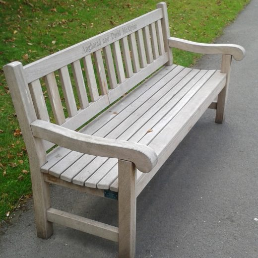 A weathered York bench in use by the Chelsea Pensioners