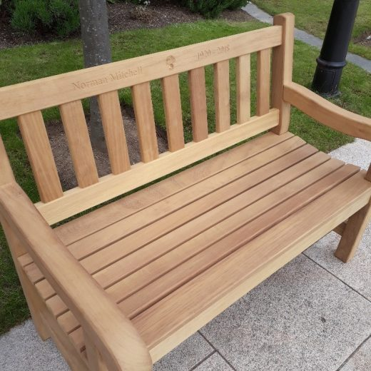 A York wooden bench in the grounds of the Royal Hospital Chelsea