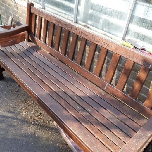 The York wooden bench with stain at the Royal Hospital Chelsea