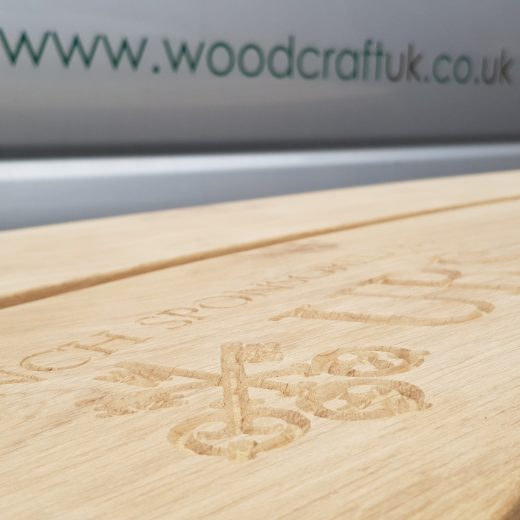 Logo inscription carved into the wooden bench