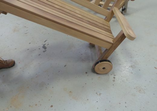 The bench can be lifted at one end and wheeled