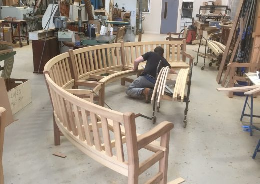 Craftsman Luke working on a bespoke curved bench