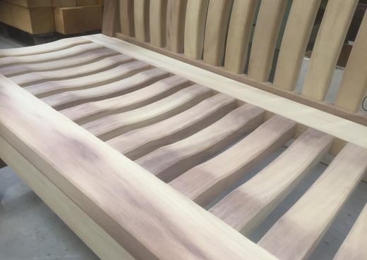 A Scarborough bench with a natural finish