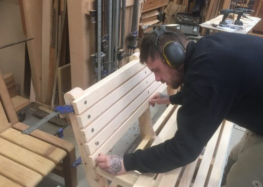 Luke assembling a bespoke wooden bench