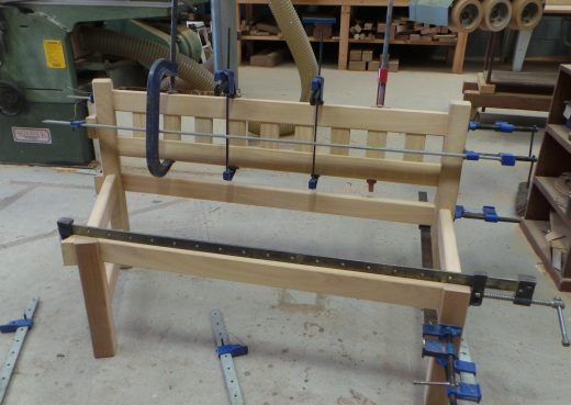 Glueing and clamping the right section of the garden bench