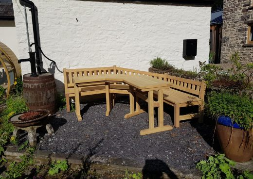 Garden bench and table in the patio area