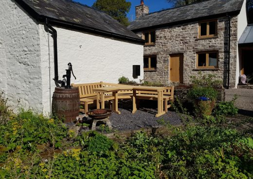 Pull out shot of the garden bench and table in situ