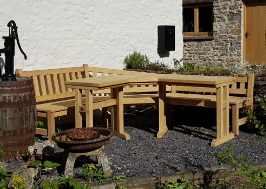 Bespoke corner angled wooden garden bench and table