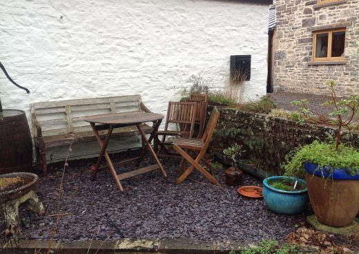 The old garden bench and deckchairs