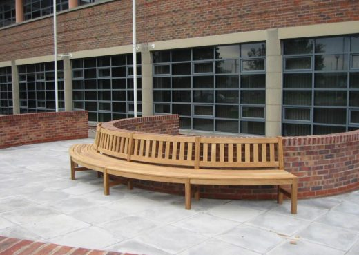 Curved street bench side view