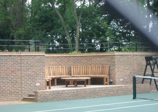 Table and curved chair set in a tennis court