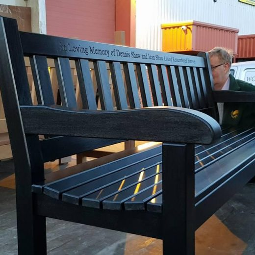 Mike, loading a set of black York benches ready for dispatch