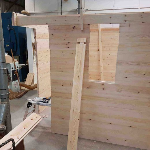 Assembling the wooden cabin in our workshop