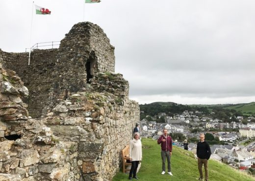 Family members it Criccieth castle with our wooden bench