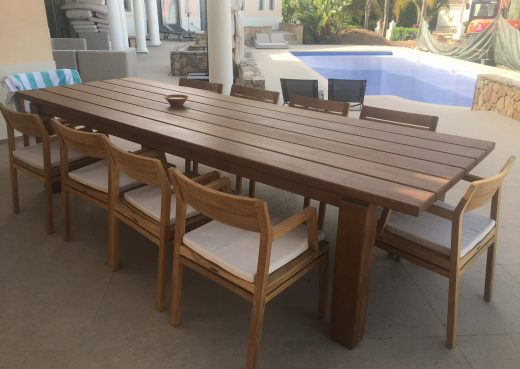 Our outdoor dining table by the swimming pool