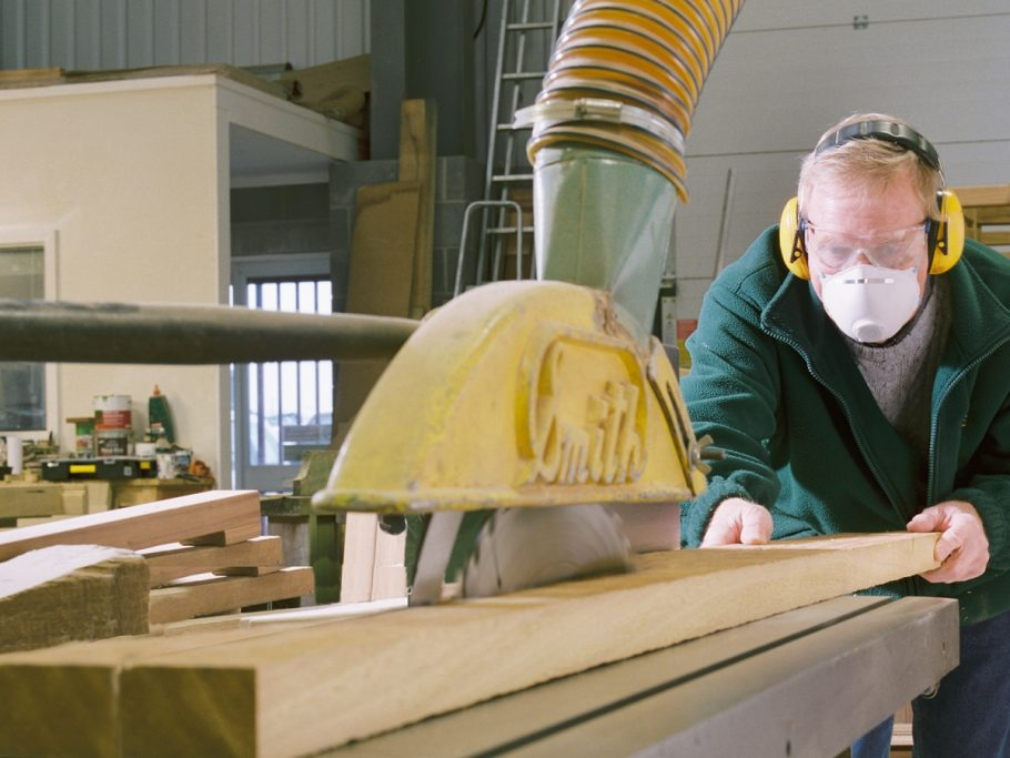 Mike Davidson cutting timber lengths for a large wooden bench