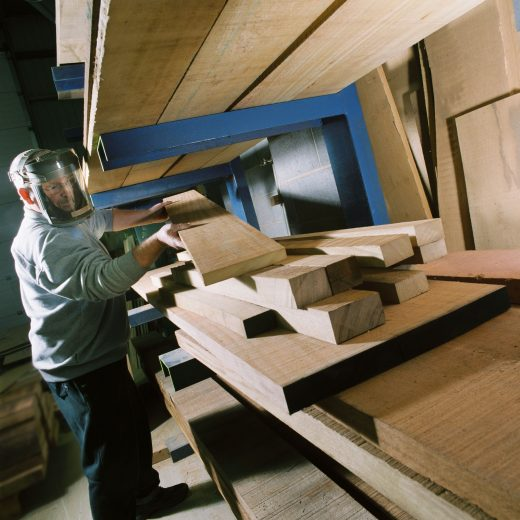 Woodcraft UK's craftsman selecting timber ready for construction of a large wooden bench