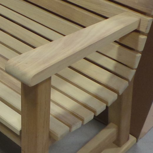 Close up of the Regent wooden seat slats and arm rest
