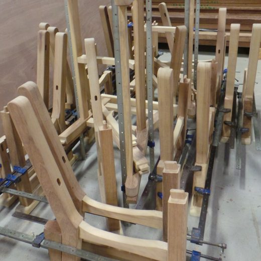 A mass of Regents Park bench components being assembled.
