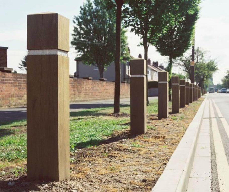 Wooden roadside bollards placed in order to prevent off road parking