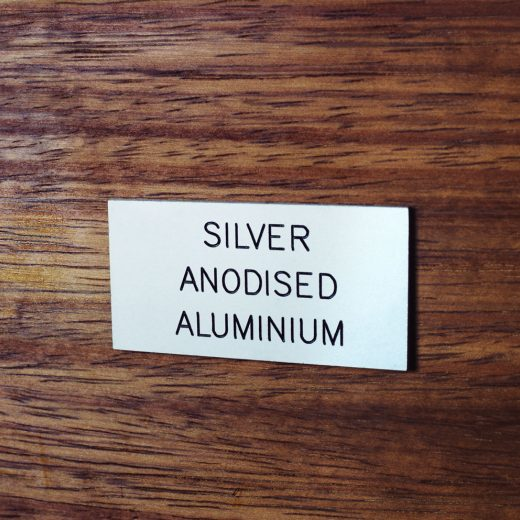 Silver anodised aluminium badge