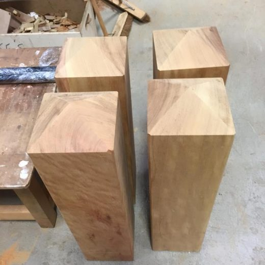 Four timber bollards in production