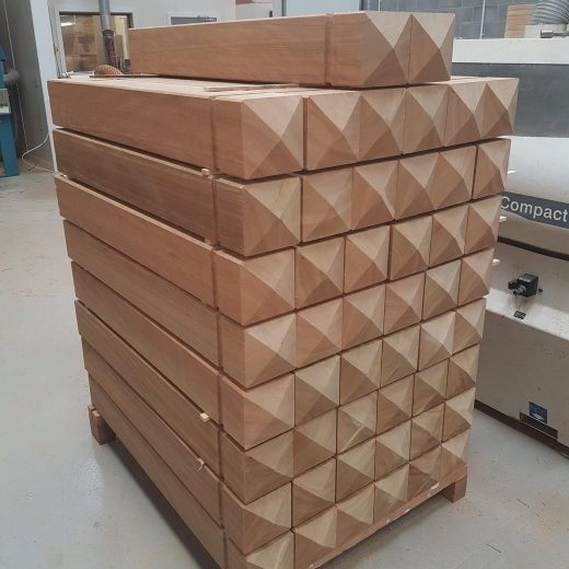 Stacked timber bollards ready for dispatch
