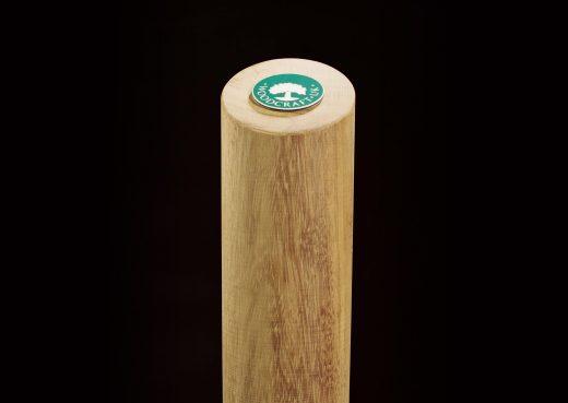 Cylindrical wooden bollard