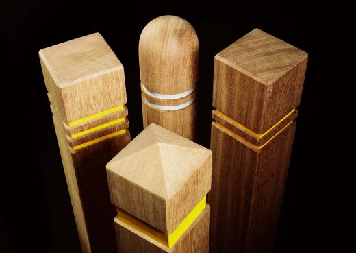 An assortment of four bollards with various reflective strips