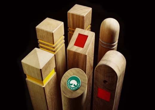 An assortment of seven bollards with reflective strips and badges