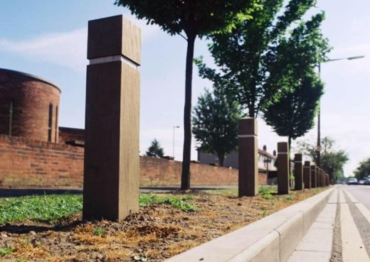 Roadside timber bollards with reflective strips