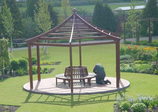 Putting the finishing touches to the circular bench in the gazebo