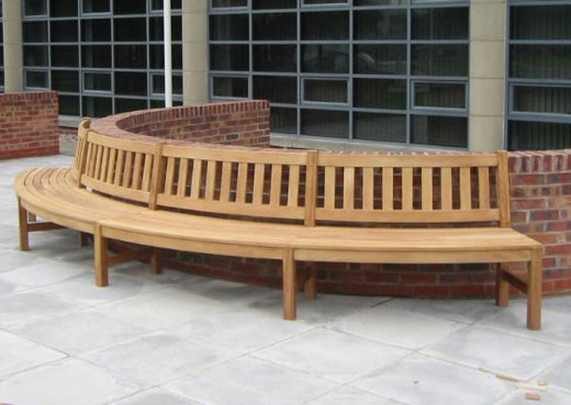 A bespoke curved wooden bench designed for street seating